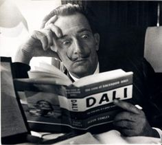 Salvador Dali reading about Salvador Dali